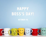 Boss day background with colorful mugs. - 225302203