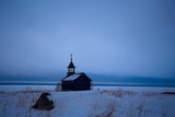 lonely wooden church in the field / concept faith, god, loneliness, architecture in the winter landscape - 225303247