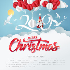 Paper art of 2019 hang with balloon in the sky, merry Christmas and happy new year celebration concept