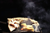 sturgeon grill / large sturgeon fish cooked on the grill, on coals with smoke, sterlet smoked - 225307230