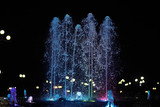 colorful night fountains / jets of colored water in a fountain, night illumination in the city, tourist object art - 225307235