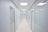 door glass plastic corridor, new office building, office rental, light blurred corridor background - 225307242