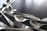 fork spoons knives background / beautiful serving tableware - 225308458