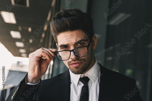 Fridge magnet Business man near business center looking camera wearing glasses.