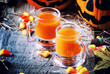 Quadro Halloween orange cocktail on a dark festive autumn background, selective focus and shallow DOF