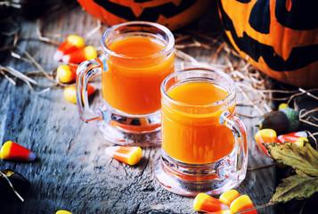 Halloween orange cocktail on a dark festive autumn background, selective focus and shallow DOF