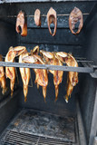 fresh smoked fish in oven. smokehouse.