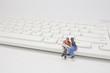 a fun of figure sit on the key board