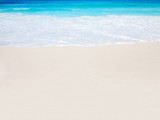 Wave of the turquoise ocean on white the sand beach. - 225332087