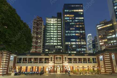 Old and modern high rise buildings in Hong Kong city at night
