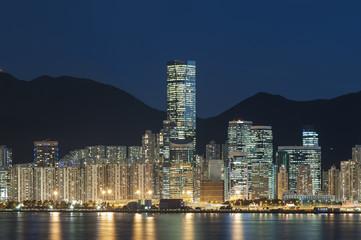 Skyline and harbor of Hong Kong city at night