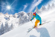 Leinwandbild Motiv Skier skiing downhill in high mountains