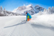 Leinwanddruck Bild - Skier skiing downhill in high mountains