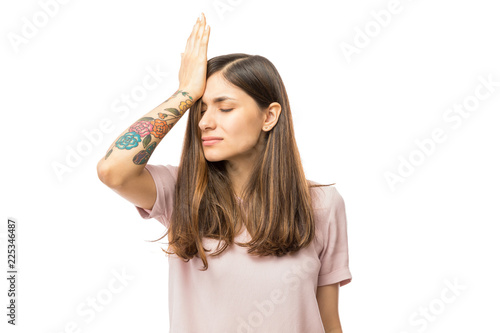 Leinwanddruck Bild Woman Realizing Mistake And Keeping Hand On Head