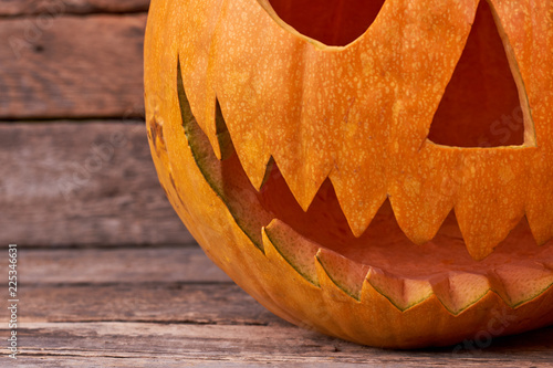 Evil Halloween pumpkin. Scary and angry Halloween pumpkin. Detail of carved Halloween pumpkin. - 225346631