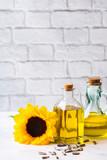 Assortment of fresh organic extra virgin sunflower oil in bottles - 225349822
