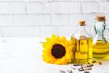 Assortment of fresh organic extra virgin sunflower oil in bottles - 225349857