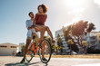 Quadro Couple riding bicycle in street