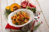 pasta with broccoli pumpkin and pomegranate - 225357211