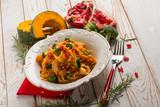 pasta with broccoli pumpkin and pomegranate - 225357211