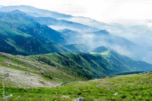 Foto Murales Hiking in the mountains (Catalan Pyrenees, Peak of Costabona, Catalonia, Spain)