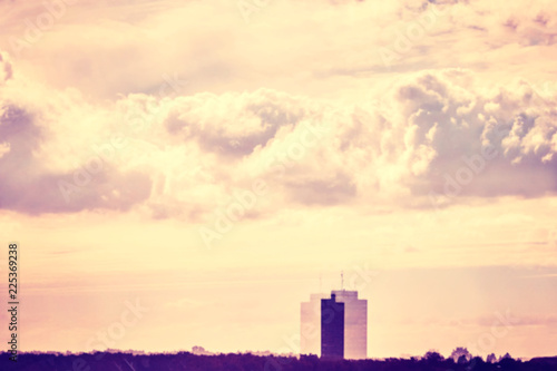 Blurred building and clouds window reflection, urban abstract background, color toning applied. - 225369238