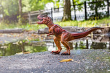 Tyrannosaurus near the water in the forest