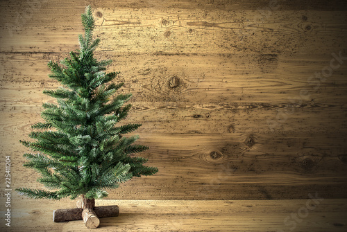 Leinwanddruck Bild Green Christmas Tree On Brown Vintage Background