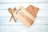 chopping board and tablecloth with wooden fork and spoon on white table , recipes food  for healthy habits shot note background concept - 225438272