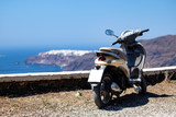 Scooter over looking Oia, Santorini, Greece - 225438481