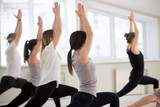 Group of young sporty people practicing yoga lesson, doing Warrior one exercise, Virabhadrasana I pose, working out, indoor, students training in club, studio close up, back view. Well-being concept - 225448286