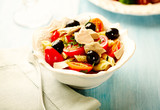 Pasta with tuna, cherry tomatoes, black olives, spices and fresh basil. Home made food. Concept for a tasty and healthy meal.  - 225457079
