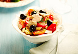Pasta with tuna, cherry tomatoes, black olives, spices and fresh basil. Home made food. Concept for a tasty and healthy meal.  - 225457206