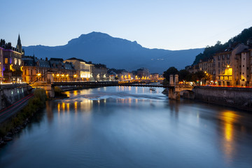 Grenoble at dusk with the river Isere, France © florent