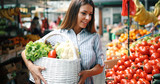 Picture of woman at marketplace buying fruits - 225475006