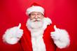 Leinwanddruck Bild - Stylish aged Santa with beard in noel costume spectacles white g