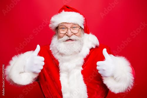 Leinwanddruck Bild Stylish aged Santa with beard in noel costume spectacles white g