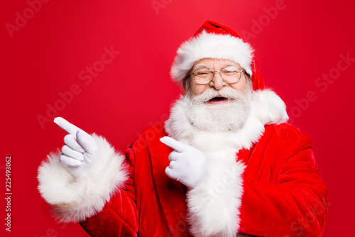 Leinwanddruck Bild Funky rejoice stylish Santa in costume gloves headwear and spect
