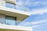 View of a house with balcony on a sunny day - 225494099