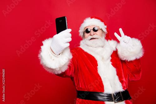 Leinwandbild Motiv Stylish trendy grandfather aged mature Santa tradition winter co