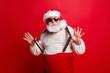 Leinwandbild Motiv Portrait of cheerful positive dreamy funky Santa congratulations