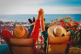 happy couple relax on balcony terrace, honeymoon