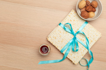 Jewish holiday Passover banner design with wine, matzo on wooden background. View from above. Flat lay