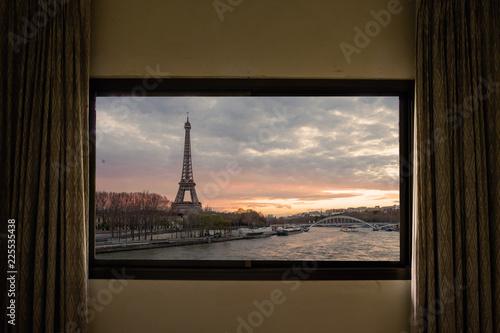 Curtain interior decoration in living room, Eiffel as seen through window.