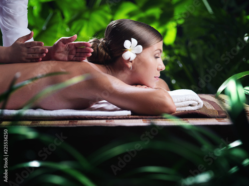 Leinwanddruck Bild portrait of young beautiful woman in spa environment.