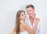 portrait of nice young couple on white  background - 225537259
