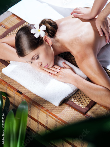 Foto Murales portrait of young beautiful woman in spa environment.