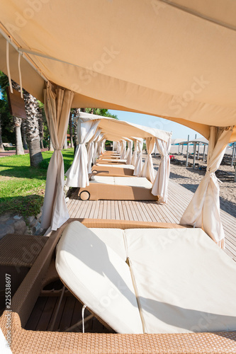 Fototapeten Strand Premium private gazebo with sofas, private sun beds and personalized service at the beach. Relaxation and luxury beach holidays