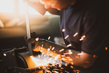 Grinding steel with lot of sparks - 225545203