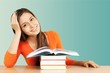 Young female student reading books